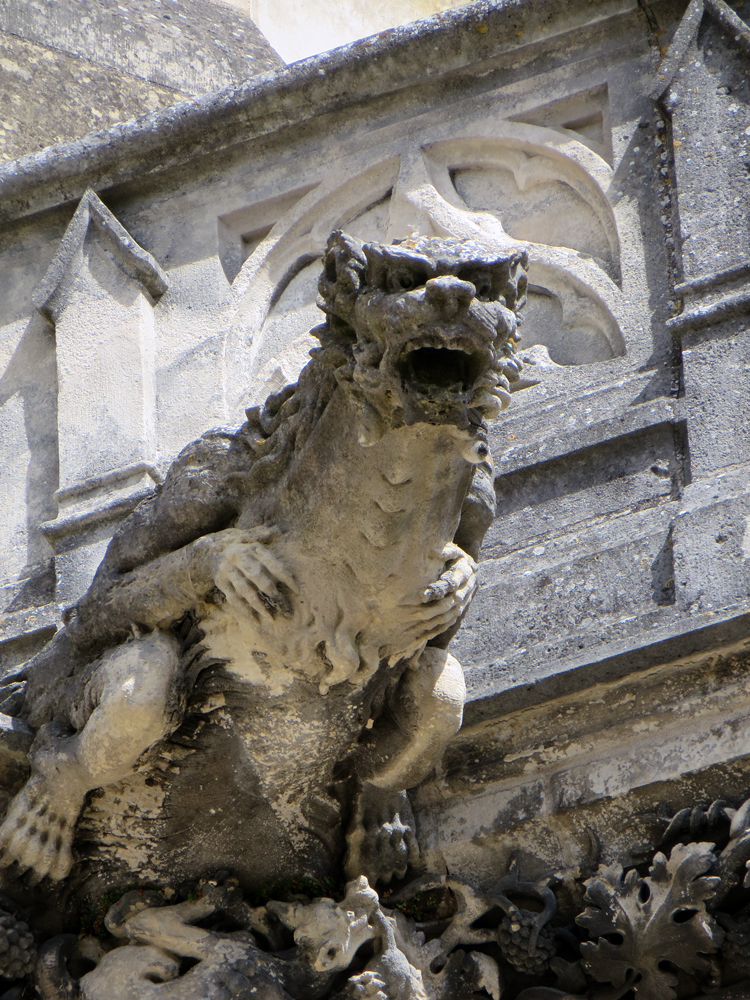 the gargoyle essay A gargoyle was originally a device mounted on the outside of a building to funnel water away from the roof the word comes from the french gargoui.